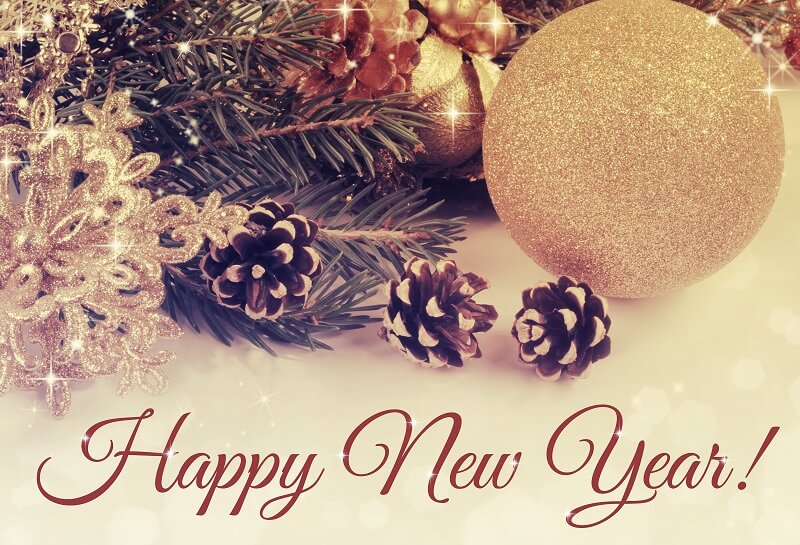 Happy New Year on a background of gold and ivory with pinecones and golden ornaments